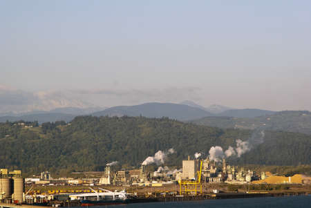 Industrital area on Columbia river with Mt. St. Helens in the background photo