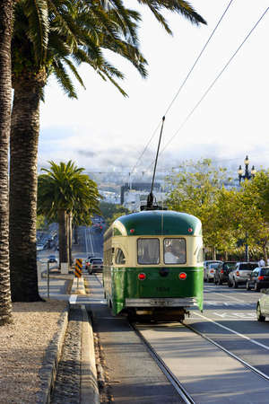 MUNI San Francisco Streetcar on a steep hill with the Twin Peaks in the background