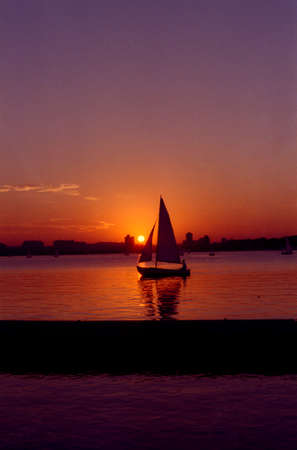 massachussets: Sailboat on Boston Charles River Basin sailing at Sunset with MIT campus in the background