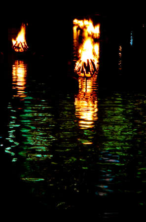 providence: Providence Rhode Island WaterFire Festival rows of fires on the water of the river at night