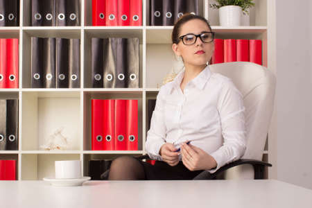 pretty brunette woman: Business woman sitting in the office Stock Photo
