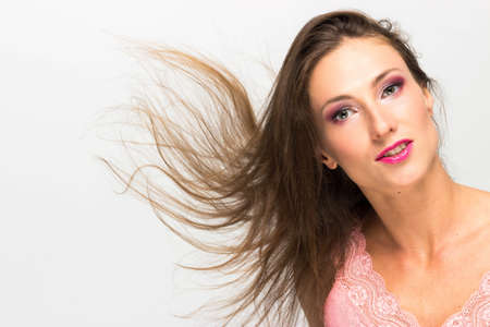 flyaway: Beautiful sexy girl with streaming hair, isolated Stock Photo