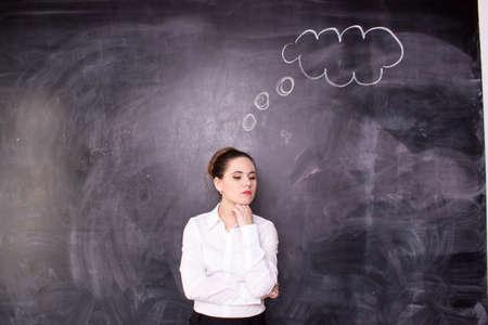 mixed race girl: Business woman or teacher thinking near the desk