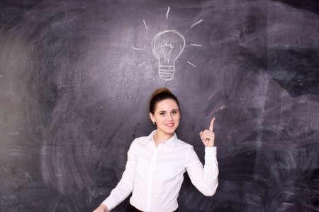 mixed race girl: Business woman or teacher have an idea near the desk