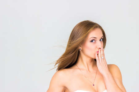 cover mouth: Sexy beautiful woman cover mouth isolated Stock Photo