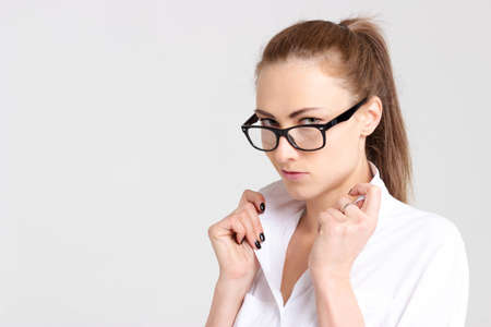 white collar: Beautiful woman correcting white collar isolated