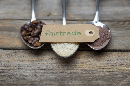 fairtrade: row of spoons with rice, coffee and cocoa