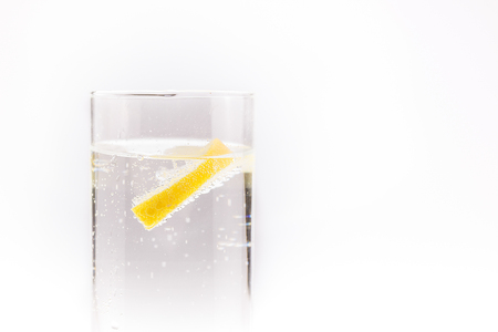 isotonic: soda water with a slice of lemon floating in