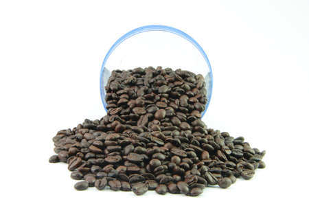 many coffee beans on the white background with  transparent jar photo