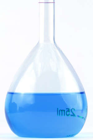 volumetric flask: Volumetric flask with blue liquid in isolated white background