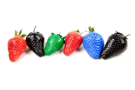 some painted colorful strawberry isolated on white background Stock Photo