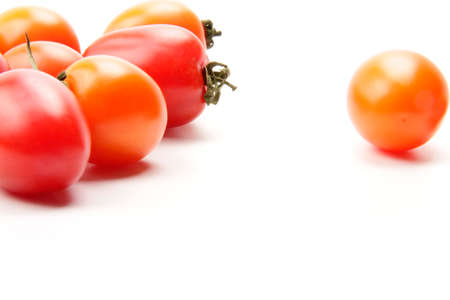 many beautiful and delicious tomatoes on the white background photo