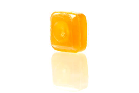 flavoured: orange flavoured hard candy isolated on the white background