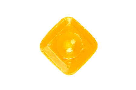flavoured: one orange flavoured hard candy isolated on the white background Stock Photo