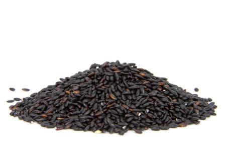 black rice: close up of black rice isolated on white background