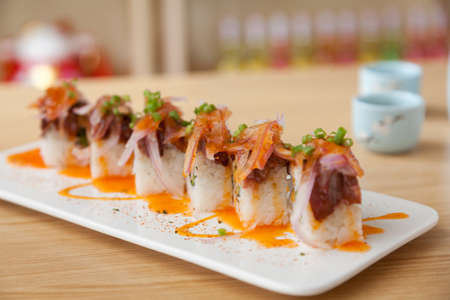 Delicious Maki Sushi in a Traditional Japanese Restaurant. Stock Photo
