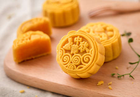 Mooncake on a wooden board. Mooncake is a kind of traditional Chinese food for Mid-autumn festival Stock Photo