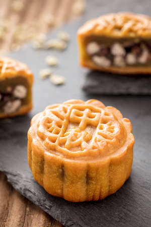 Mooncake on a black plate. Mooncake is a kind of traditional Chinese food for Mid-autumn festival Stock Photo