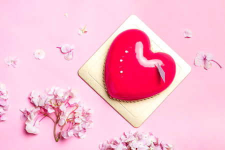 patisserie: Heart-shape Mousse Cake on Red and Blue Background with Hydrangea.
