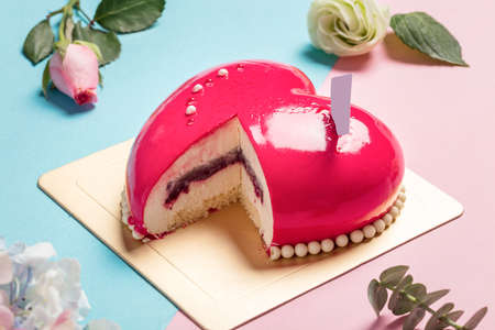Heart-shape Mousse Cake on Red and Blue Background with Hydrangea.