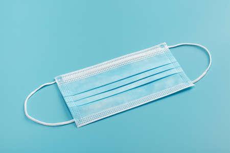 Medical mask on blue background. 版權商用圖片