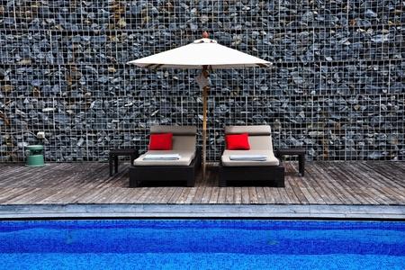 Sunbeds beside the pool, Hua Hin, Thailand photo