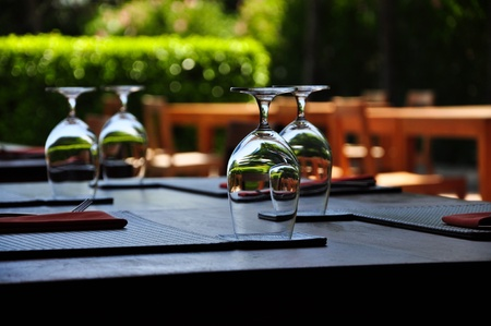 fine wood: Decorated outdoor dining table Stock Photo