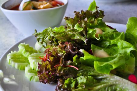 Fresh salad with thousand island dressing photo