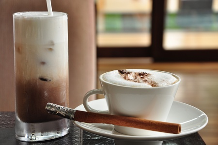 Ice chocolate and hot cappuccino photo