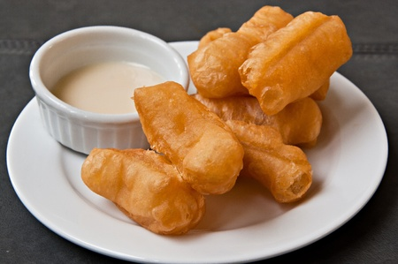Deep-fried traditional Thai doughstick served with condensed milk photo