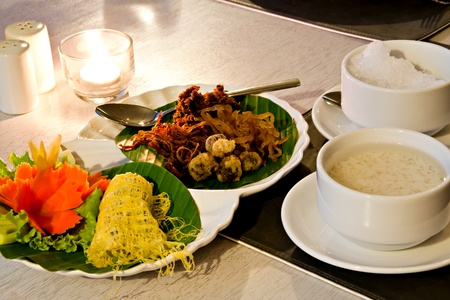 Khao Chae, an ancient Thai food, rice in cold water with ice served with various Thai side dishes photo