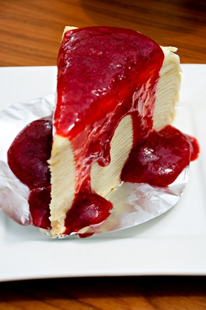 Crape cake with raspberry sauce photo