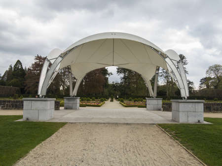 a modern band stand in a large park