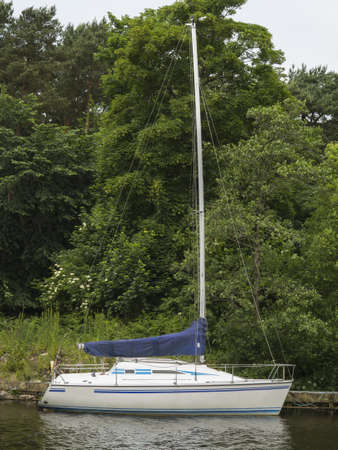 sail boat on a river in co Antrim Ireland Stock Photo