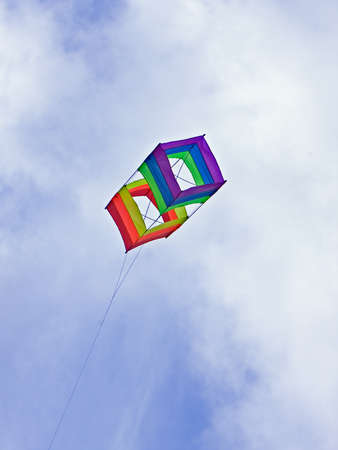 box kite shot against deep blue sky Stock Photo