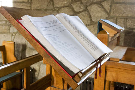 bible open in a church ready for service Stock Photo