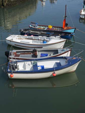 some boats in harbor Annalong harbor ireland