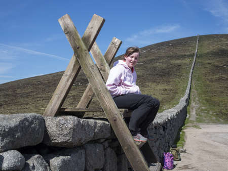 girl taking a break from walking in the mournes Ireland