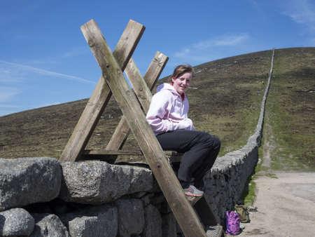 girl taking a break from walking in the mournes Ireland