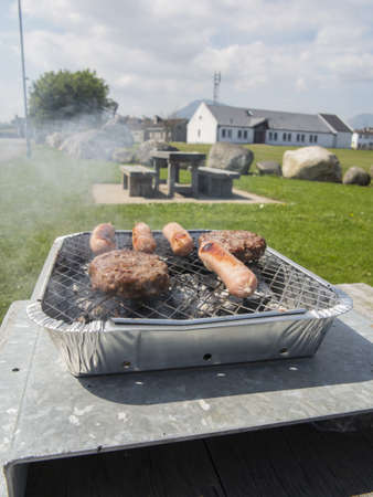 meat cooking on a disposable bbq
