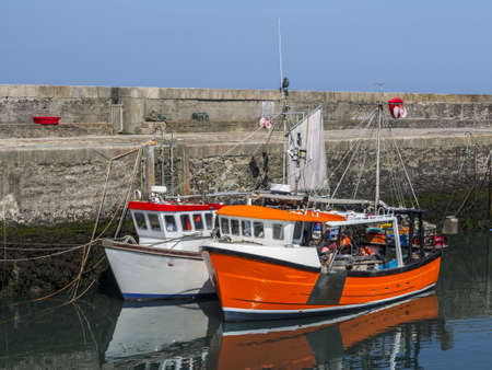 two large working boats in annalong harbor