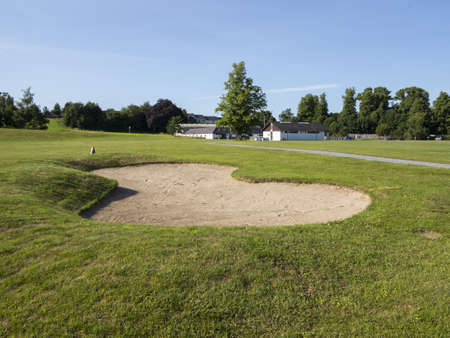 bunker on a golf course in the summer time Stock Photo