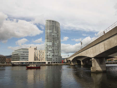 The river lagan in belfast with office blocks in background Stock Photo