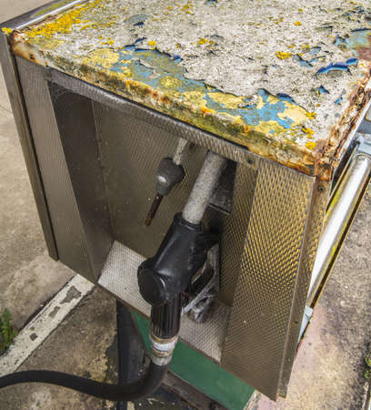 petrol pump with signs of bad decay Stock Photo - 21820645