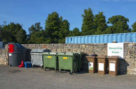 urban recycling yard with multiple types of bins