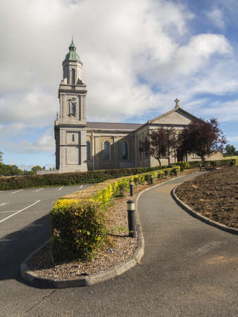 large irish church with cross and steeple