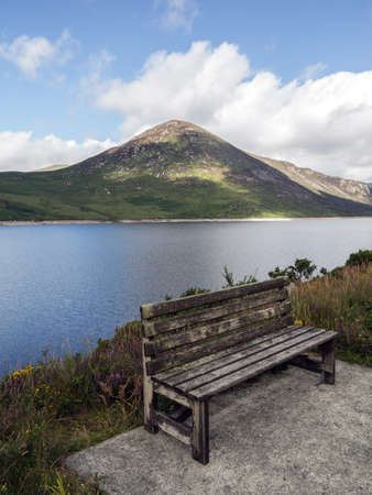a summer seat beside silent valley reservoir Stock Photo