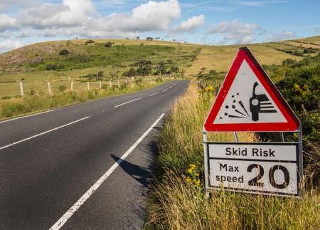 warning sign concerning dangerous road surface