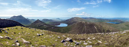 a panorama taken of the mourne mountains includes slieve binnian and doan mountain also fofanny reservoir