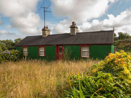 an old derelict house with overgrown weeds Stock Photo - 22283527